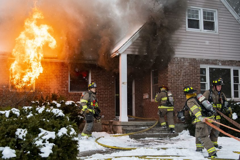 Schenectady firefighters battle a fire at 1487 Wyoming Ave. Monday