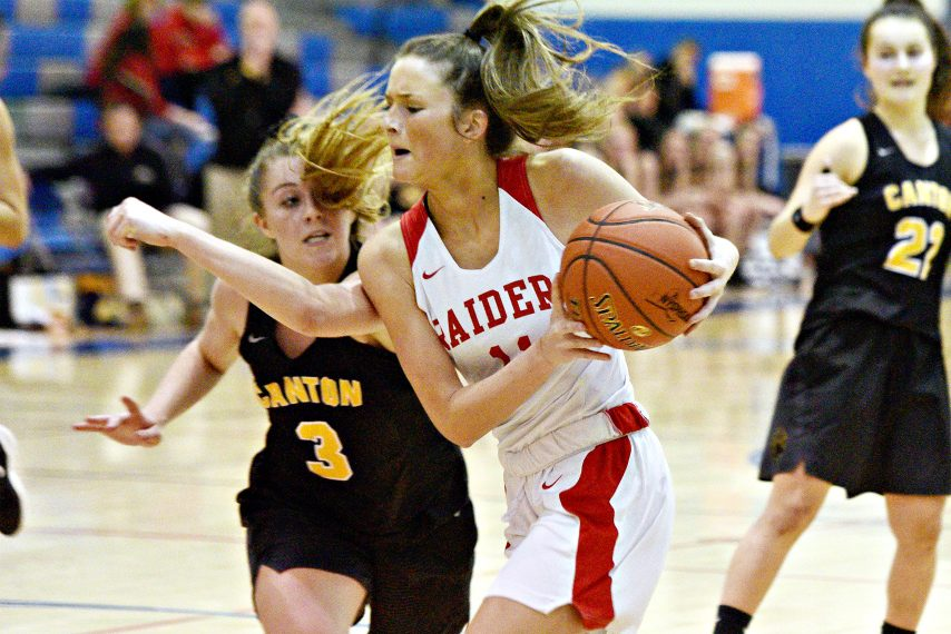 ERICA MILLER/THE DAILY GAZETTEMechanicville's Charli Goverski with the ball against Canton's Catherine Chisholm during the Class B basketball regional semifinals at Saratoga Springs High School on Tuesday, March 10, 2020.