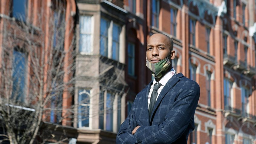 Re'Shawn Rogers, of Albany, stands outside on N Pearl Street, in Albany on Thursday.