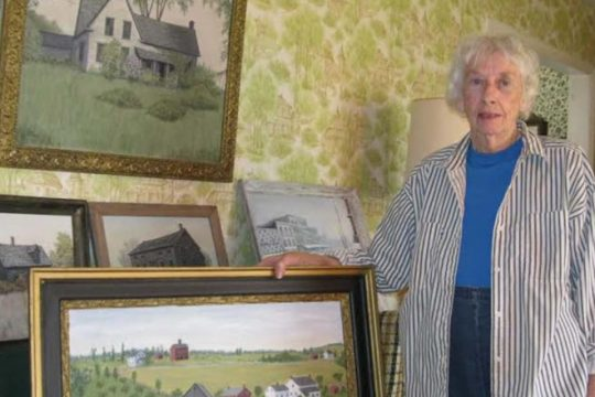 Irma Mastrean, former town of Princetown historian, shows off some of her paintings inside her home back in 2014.
