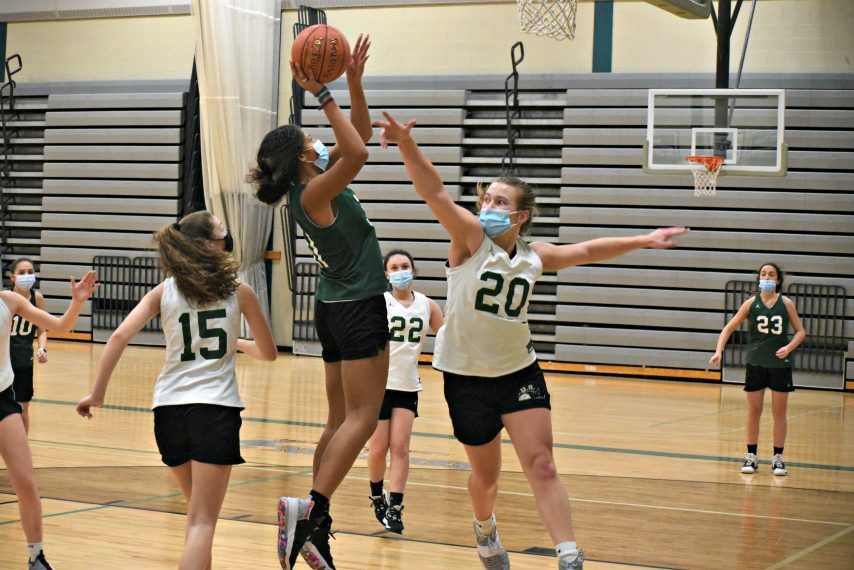 Schalmont's Haley Burchhardt closes in on Karissa Antoine's jump shot during Tuesday's practice at Schalmont High School.
