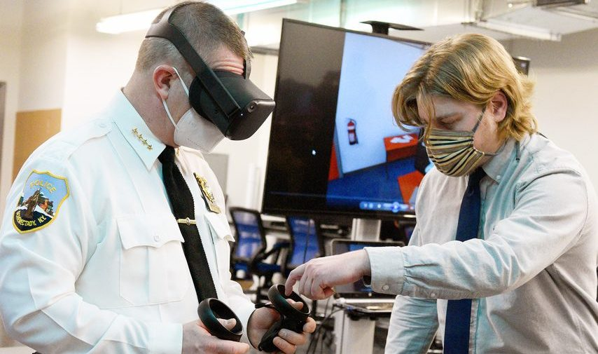 Catapult Games lead developer Gabriel Langlois, right, helps Schenectady Police Chief Eric Clifford set up a demonstration of Catapult's virtual reality de-escalation training program on Tuesday at Urban Co-Works in Schenectady.