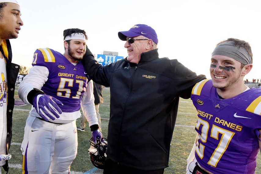 UAlbany football head coach Greg Gattuso celebrates with Niko Culnan and Hayden Specht after the Great Danes' FCS playoff win over Central Connecticut State on Nov. 30, 2019.