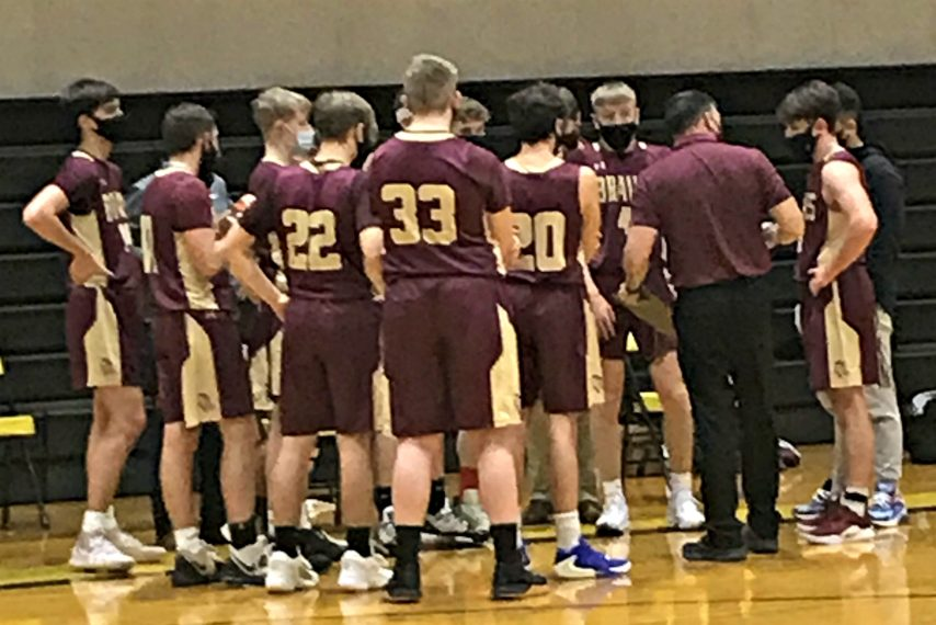 """The Fonda-Fultonville boys basketball huddles during a timeout on the road at Canajoharie High School Wednesday night in its """"high"""" risk season opener."""