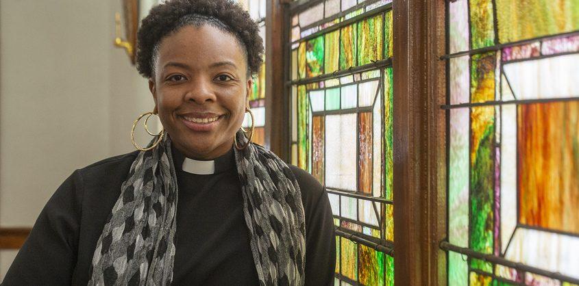 Rev. Nicolle D. Harris, pastor at Duryee Memorial A.M.E. Zion Church, inside her church on Hulett Street Wednesday.