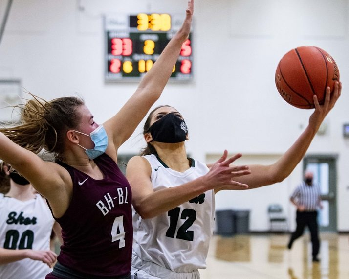 Shenendehowa's Rylee Carpenter takes a shot over Mary Katherine Lescault of Burnt Hills-Ballston Lake during Thursday night's Suburban Council basketball game at Shenendehowa High School.