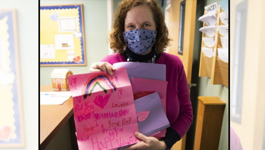 Saint Kateri Takakwitha Principal Tosha Grimmer holds Valentine's Day cards Thursday.