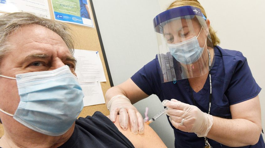 Tom Ellis, of Schuylerville, receives his second dose of the COVID vaccine shot from Saratoga County DPH RN Shana Phelan at the Saratoga County Department of Public Health Offices in Ballston SpaThursday.