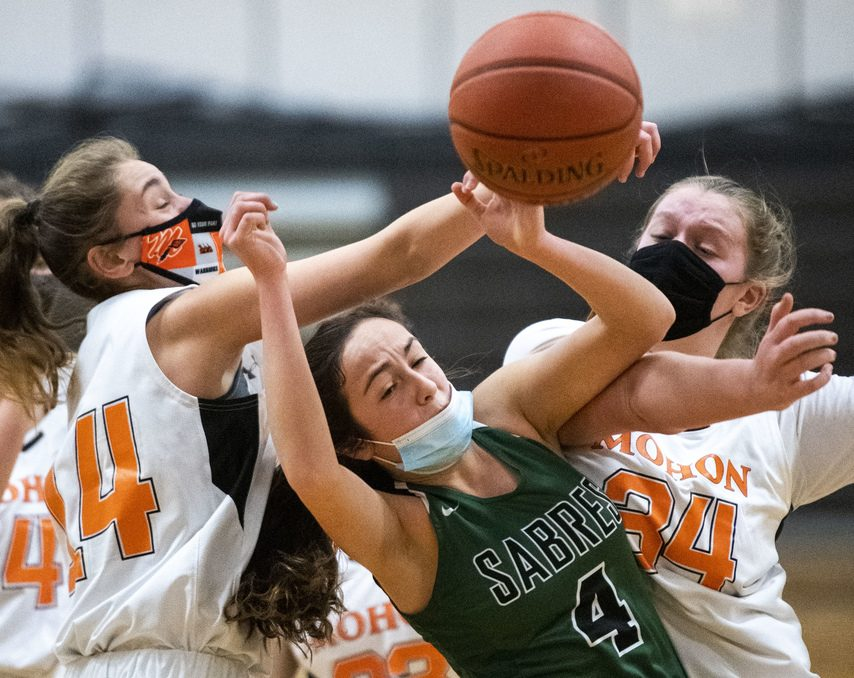 Schalmont's Payton Graber fights through pressure from Mohonasen's Payton Whipple and Ava Quenneville (34) during Friday's game at Mohonasen High School.