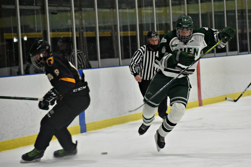 STAN HUDY/THE DAILY GAZETTE Shenendehowa's Austin Haldane is up in the air and on his way down onto the ice, cut off by Burnt Hills/Ballston Spa's Antonio Rossetti during first period action Friday at the Clifton Park Arena.