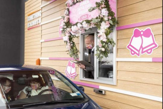 Selena Stallmer and Brian Dinsmore of Niskayuna take their wedding vows on Friday at a Dunkin' in Middletown.Courtesy of Dunkin' Donuts