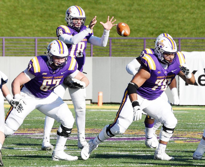 UAlbany offensive lineman Kobe Thomas (70) blocks for quarterback Jeff Undercuffler in 2019.