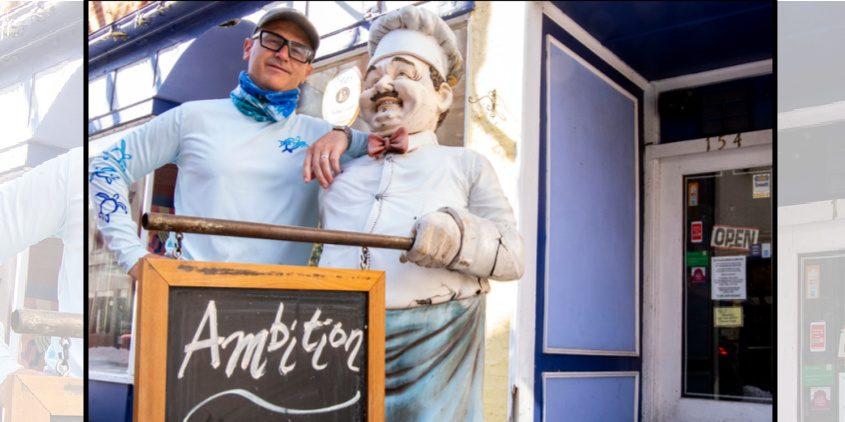 Ambiton Café owner Mark Renson in front of his establishment Saturday