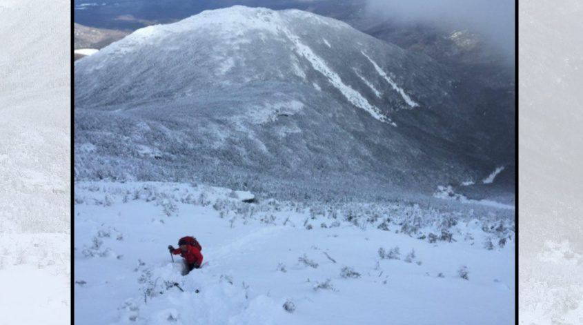 A DEC Forest Ranger hikes through three-foot-deep snow on Algonquin Peak in this 2017 photo. Credit: NYSDEC