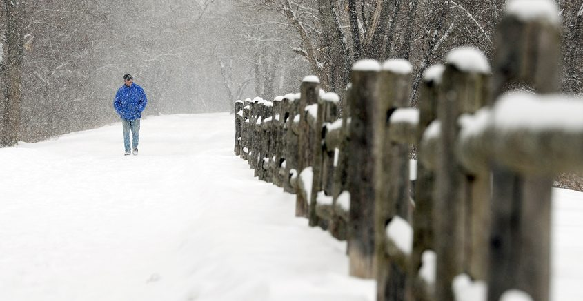 Larry Colman, of Niskayuna, enjoys a relaxing peaceful walk in the snow on his day off at Lions Park along Mohawk River in Niskayuna last week