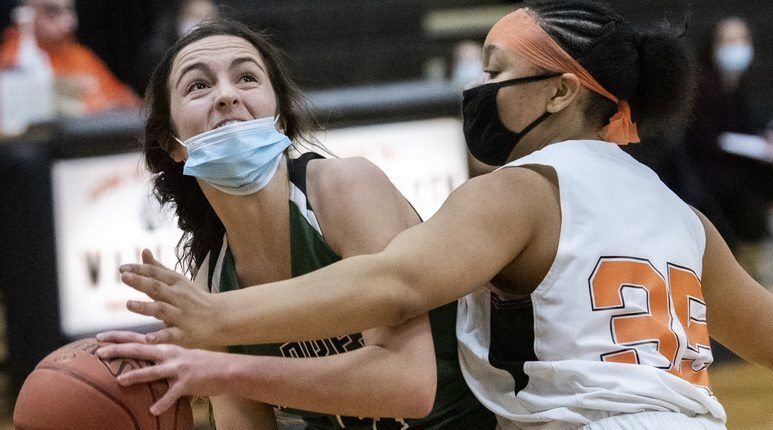 Schalmont's Payton Graber takes a shot while being blocked by Mohonasen's Jahd'dah Lennon during a girls' basketball game Friday at Mohonasen High School.