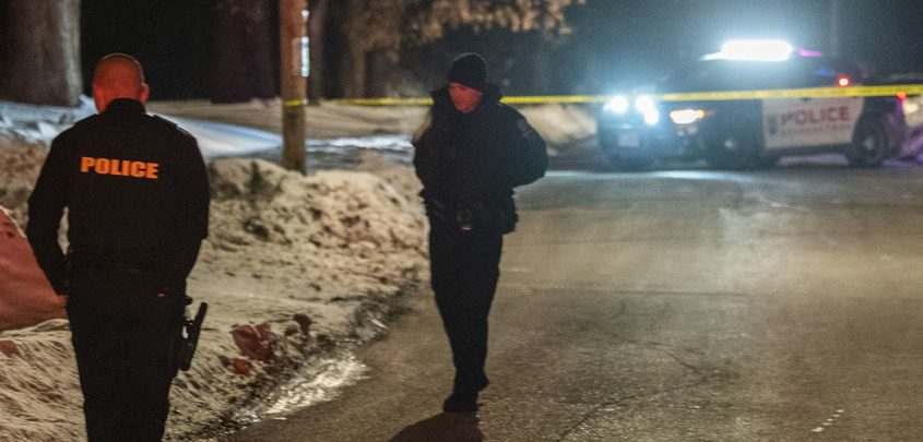 Schenectady police officers look for evidence on Wyllie Street after a man was shot Friday evening near Brandywine Avenue.