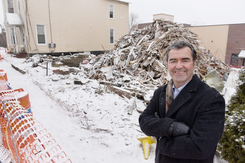 City Mission of Schenectady Executive Director Mike Saccocio stands Monday in front of the demolition site where a building with 10 units of transitional housing will be built on Lafayette Street.