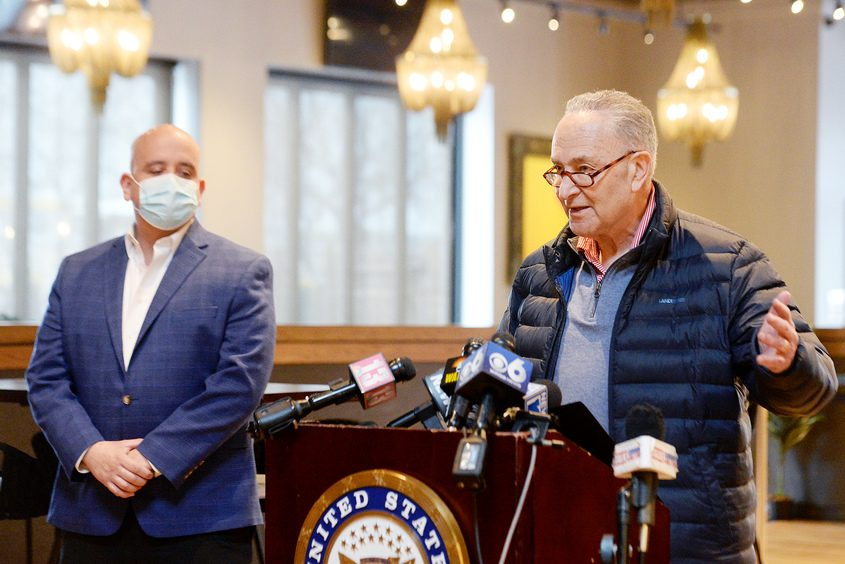 ERICA MILLER/THE DAILY GAZETTE Senate Majority LeaderCharles Schumer speaks Monday at TORO Cantina in Colonie. Listening at left is chef and owner Jaime Ortiz.