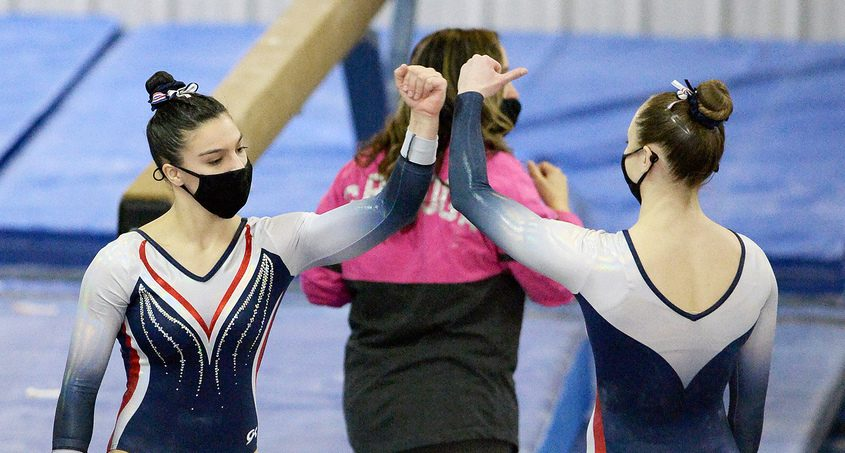 Saratoga's Sophia Damiano with Ava Dallas (right) after competing in the beam during the Suburban Council gymnastics championships at World Class Gym in Latham Sunday