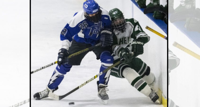 Saratoga's Joe Amodio takes Shenendehowa's Joe Celtruda off the puck during Tuesday's game.
