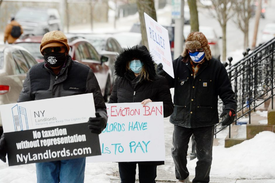 ERICA MILLER/THE DAILY GAZETTE Landlords hold their signs outside the steps of Governor Andrew Cuomo's mansion on Eagle Street as landlords protest lifting the eviction ban in New York State in Albany on Thursday, February 18, 2021.