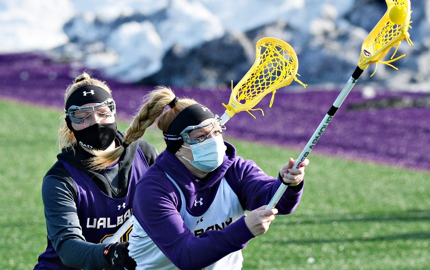 UAlbany's Madison Conway, right with the ball against Jordyn Marr during their lacrosse practice on Wednesday, February 17, 2021.