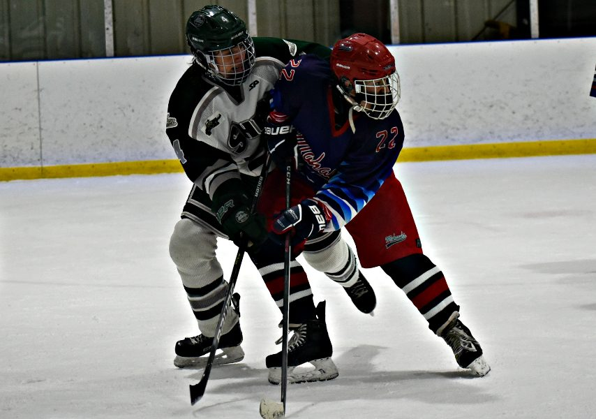Shenendehowa's Marty Magaletta (left) battles with Mohawks' Paolo Coppola in front of the Plainsmen net at the Capital Arena Friday afternoon during Section II ice hockey action. Feb. 19, 2021