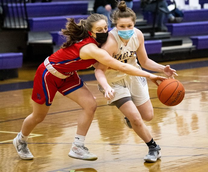 Allison O'Hanlon of Duanesburg is fouled by Maple Hill's Alexis Tedford during Friday's non-league girls' basketball game at Duanesburg High School.