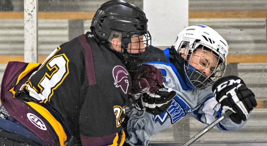 Burnt Hills/Ballston Spa's Bernie Townsend takes G/M/S/V/S Storm's Michaiah Minns to the boards Saturday
