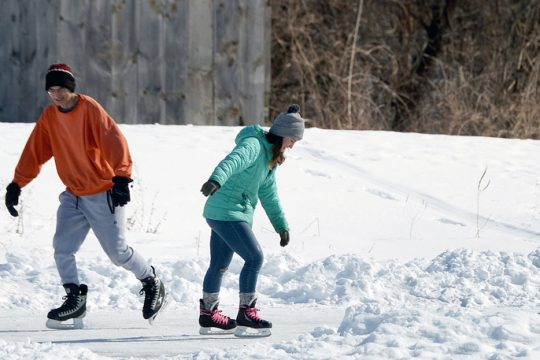 Joseph Shiang, of Niskayuna, ice skates with his daughter Orit, 17, at the Blatnick Park pond on a sunny day in Niskayuna on Sunday