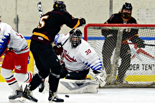 BHBS's J.D. Townsend makes a shot at Mohawks' goalie Alex Doehla during their hockey game at SCRF in Glenville on Monday.