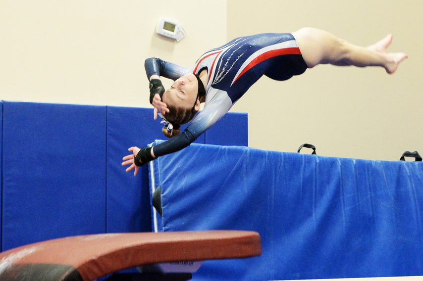 Saratoga Springs senior Megan Wishart competes on the vault during a dual high school gymnastics meet against Guilderland at the Saratoga Regional YMCA in Wilton.