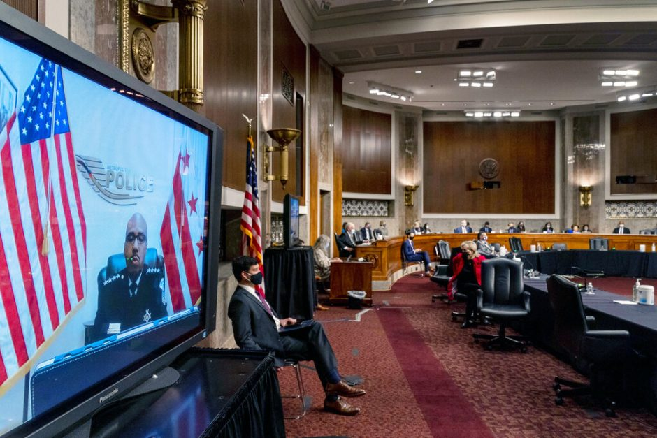 Washington Metropolitan Police Department Acting Chief of Police Robert Contee III, left, testifies via teleconference Tuesday