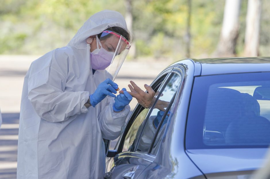 At a drive-up testing site, Covid Clinic medical assistant Jennifer Quinlan collects a sample for COVID-19 testing at the San Elijo Campus of Mira Costa College on April 15, 2020, in Cardiff, California.