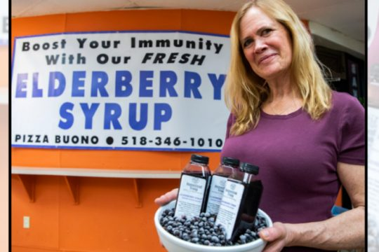 Christine Hansen with Elderberry syrup she has for sale at Pizza Buono in Niskayuna