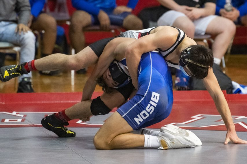 Niskayuna's Jack Schiavo and Shaker's Mike Santore wrestle in the 132-pound weight class Thursday at Niskayuna High School.