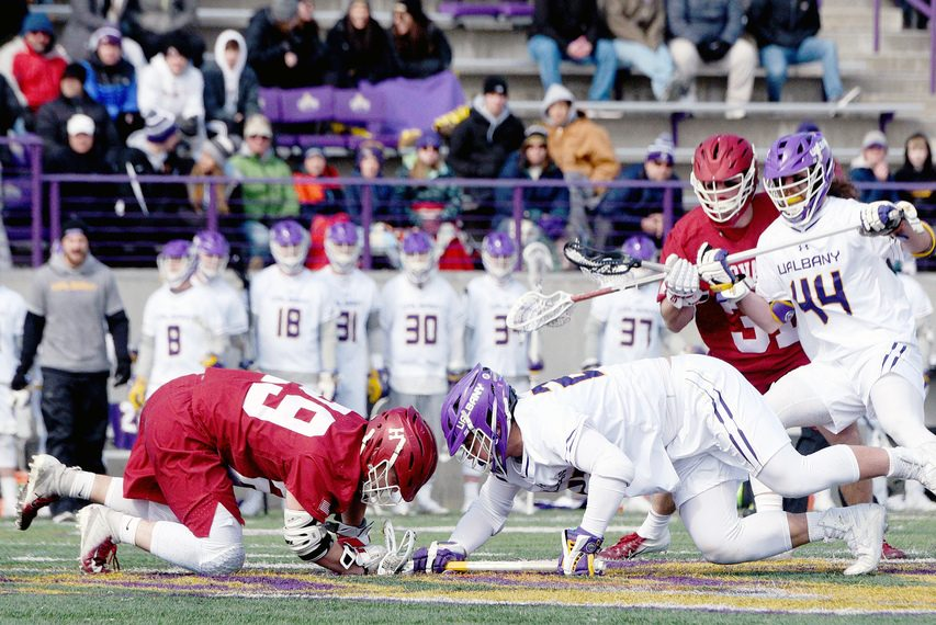 ERICA MILLER/THE DAILY GAZETTEUAlbany's Anthony Altimari, right, in a faceoff against Harvard's Steven Cuccurullo during their game at Casey Stadium on Feb. 29, 2020.