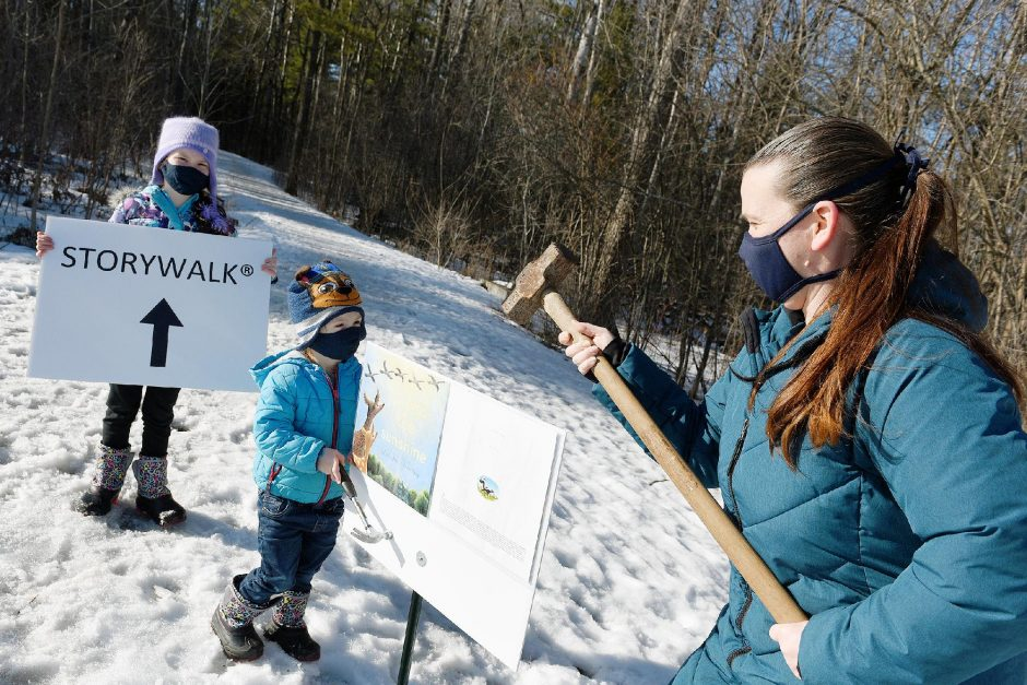 """ERICA MILLER/THE DAILY GAZETTE Becky Neyhard of Niskayuna, with her two children, Rylan, 2, and Cami, 6, are pictured on the Storywalk trail at River Road Park in Niskayuna on Thursday.Neyhard will be installing a Storywalk with the book,""""If I Was The Sunshine,""""€ by Julie Fogliano and Loren Long, this weekendalong a half-mile trail."""