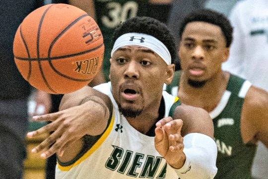 Siena's Jalen Pickett makes a pass during Friday's game in Loudonville. (Peter R. Barber/The Daily Gazette)