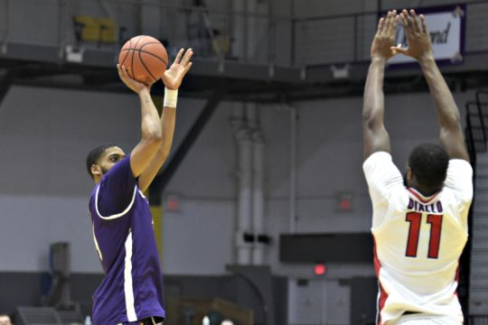 Jarvis Doles, left, takes a shot during a game earlier this season. (Kathleen Helman/UAlbany Athletics)