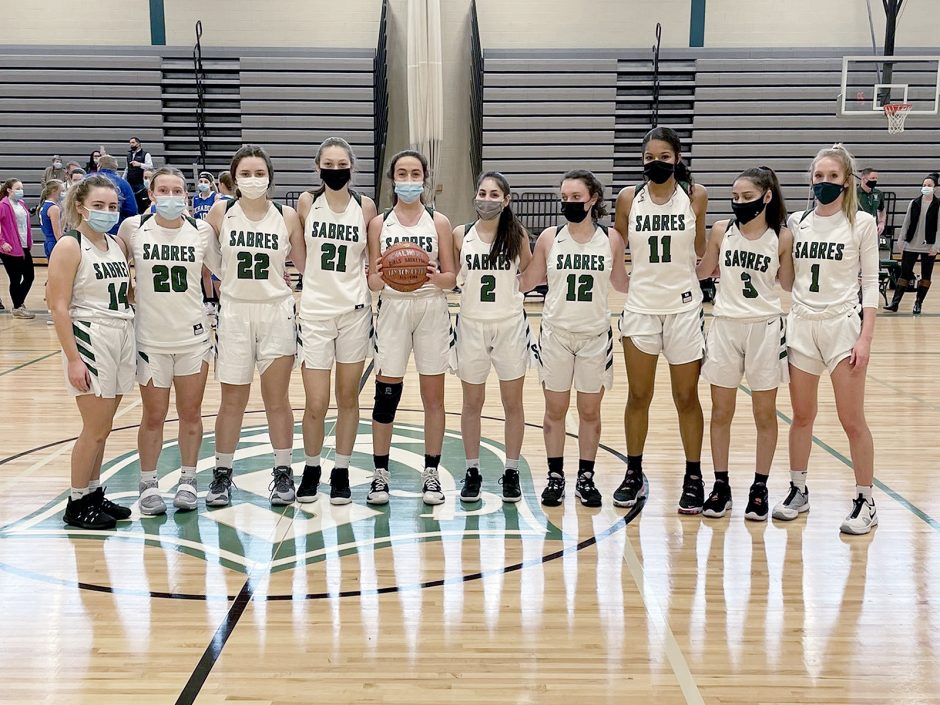 Photo providedSchalmont junior guard Payton Graber holds the basketball while her teammates stand with her after she became the school's all-time scoring leader in girls' basketball on Saturday against Ichabod Crane.