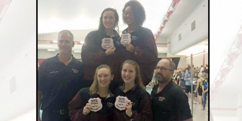 Burnt Hills/Scotia swimming coach Matt Turner, right, poses with members of the girls' team during a 2015 meet. Credit: Burnt Hills/Ballston Lake School District