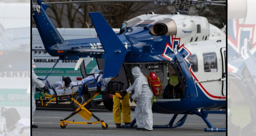 A COVID-19 patient is removed from a Westchester Medical Center helicopter for transport to nearby Ellis Hospital onApril 5, 2020.