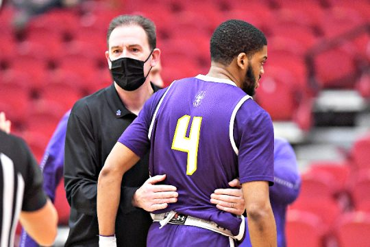 UAlbany men's basketball head coach Will Brown, left, and Jarvis Doles are shown during Sunday's season-ending loss. (Steve McLaughlin/America East)