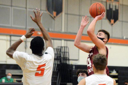 Scotia-Glenville's Ben Kline shoots over Mohonasen's Nayshawn Williams during the teams' high school basketball game at Mohonasen on Monday. Scotia-Glenville prevailed, 67-50. (Erica Miller/The Daily Gazette)