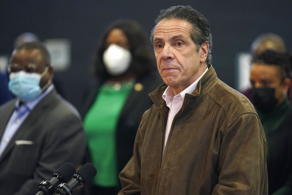 Gov. Andrew Cuomo, right, pauses to listen to a reporter's question during a news conference Feb. 22