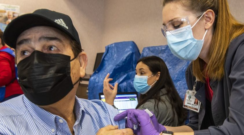 Hugo Gonzalez of Amsterdam gets his COVID-19 vaccination from Amanda Bearcroft at Riverfront Center Saturday.