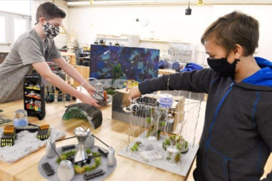 "Eighth-grader Sawyer Brannigan, left, and Gregory Tomik, both 13, members of a team of seventh- and eighth-graders at O'Rourke Middle School in Burnt Hills, lay out their ""Spartemis City."""