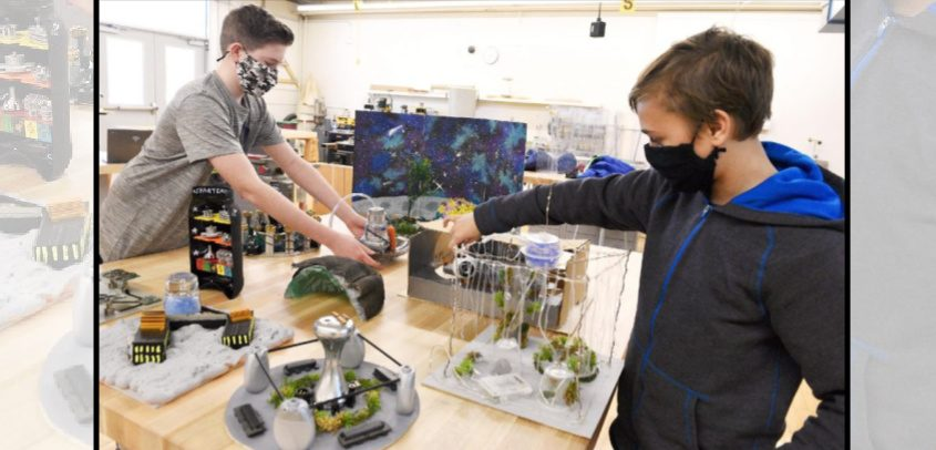 """Eighth-grader Sawyer Brannigan, left, and Gregory Tomik, both 13, members of ateam of seventh- and eighth-graders at O'Rourke Middle School in Burnt Hills, lay out their """"Spartemis City."""""""